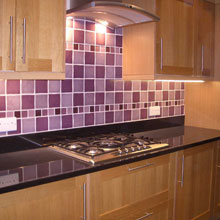 White and purple mosaic with basin